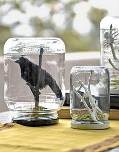 I'm going to do this, inverted, with jars hanging from the bottom of a cabinet, for both spices, and weird junk resembling bat wings and eyeballs.  Dad was telling me we have jars in the garage he always intended to make into something similar for his tool area.  Some of them are my old baby food jars!