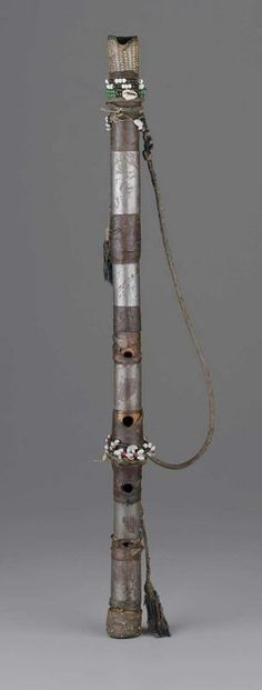 End-Blow Flute | Most likely from Sudan | 19th century | Wood, tin, animal skin, seed beads