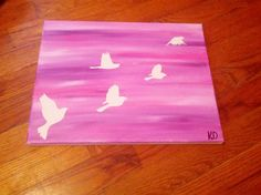 Bird painting by me! Diy: take any stickers or tape and make a design on your canvas. Then paint away! Peel off your stickers and you will be left with the plain color from your canvas. You can also layer and paint your canvas a color before you sticker or tape it!