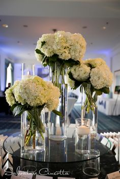 flower arrangements for wedding aisle w hydrangas   The white hydrangeas appeared at the ceremony first as aisle ...