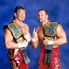 Check out photos of the WWE Superstar tandems (and one trio) who have held the Raw Tag Team Titles, including The Street Profits. Wrestling Stars, Wrestling Wwe, Tim Burton, Wwe Lucha, Attitude Era, Wwe Belts, Eddie Guerrero, Wwe Tna, Wwe World