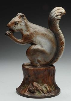 "Superb depiction of squirrel with nut on stump with very realistic form and paint. Condition (Excellent). Size 9 - 1/2"" T."