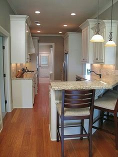8 small er kitchens my readers cook in for Galley kitchen with breakfast bar