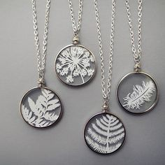 Handcut paper feathers and leaves encased between 2 micro-thin pieces of glass. Cut by hand with an x-acto knife and ready to wear with a 24inch silver chain.
