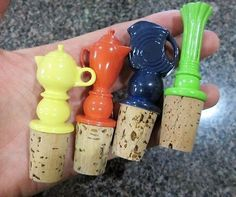 Fiesta® 4 Piece Wine or Cruet Cork Stoppers: ~ Each has a different Fiesta® item on top: Teapot, Coffee Pot, Pitcher, Vase in Fiesta® colors | WorthPoint