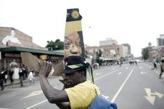 An unidentified ANC supporter sings early in the morning as he waits for ANC President Jacob Zuma to appear in court on Feb. 4, 2009, in Pietermaritzburg, South Africa. Zuma fought a long legal battle over allegations of racketeering and corruption, resulting from his financial adviser Schabir Shaik's conviction for corruption and fraud. On April 6, the National Prosecuting Authority decided to drop the charges, citing political interference. He won the election on May 6 and was sworn in SA…