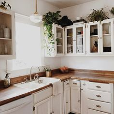 Our house is well over 100 years old, and with that came an old kitchen. I thought I'd want to renovate it right away but with just a few small changes, it's really grown on me. I'll post a before and after later