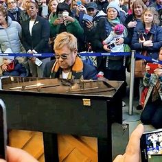 Hot: Elton John plays surprise concert in London train station