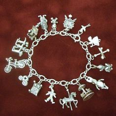 Vintage Sterling Charms Bracelet With 16 Exceptional Storybook Childhood Nursery Rhyme Theme Charms..