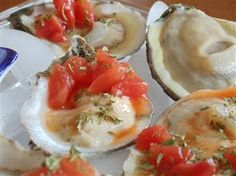 Oysters on the half shell, on ice with bits of pink grapefruit on the shell! OMG!
