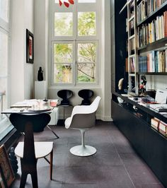 Reading spot/home office featuring Tulip chair (Saarinen for Knoll) and Ant chair (Jacobsen for Fritz Hansen).