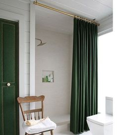 Hang A Curtain From The Ceilings To Create The Illusion Of A Larger Shower.  Give