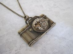 Camera Necklace on Etsy. So cute!