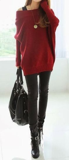 Burgundy loose sweater with black pant and boots