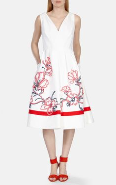 """Karen Millen Australia COLOURFUL FLORAL RIBBON """"This sleeveless wrap full skirted dress features contrast floral ribbon embroidery tapework. A key piece from our SS15 collections, our designers used 100 yards of tape and took 12 hours to create this piece. Product Code: DV153"""""""