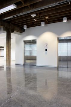 Exposed beams  polished concrete floors.  Wilcox Mofflin Building, Ultimo - Refurbishment and Amenities Upgrade  By www.parkviewgroup.com.au Interiors Division