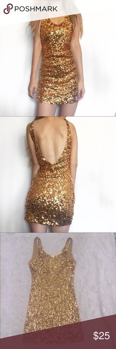 Gold sequin dress BNWOT Brand new gold sequin dress every piece of sequin is in tact. Looks gorgeous and you will get so many compliments when wearing this. Honestly such a stand out dress and hard to find. Brand is llove bought from LA fashion district Lulu's Dresses