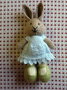 Knit with many modifications: jointed legs, larger shoes, shorter arms and tweaks to her little face to get an expression I liked.  (The old link to the hem edging is missing….please see belo...