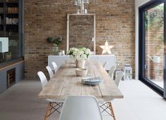 A modern farmhouse dining room might just be the dining room design of your dreams. A farmhouse dining room is a gorgeous dining room design that has a very bright tone. It is a combination of a traditional dining house… Continue Reading → Dining Room Design, Dining Room Table, Dining Decor, Kitchen Decor, Brick Wall In Kitchen, Living Room Brick Wall, Scandi Dining Table, Conservatory Dining Room, Console Table
