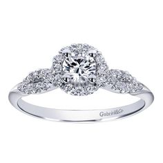 This is a simple ring with such a beautiful style and has such a great price. We absolutely adore this 14k White Gold Diamond Halo Engagement Ring by Gabriel & Co. This beauty has such a unique and cute style.