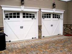 Steel carriage style door with a composite overlay