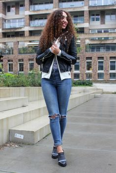 """Larissa Bruin of """"From Hats to Heels"""" wearing a white zip hoodie by Citizen Cashmere under her Mostwanted Jacket."""