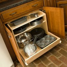 Installing a drawer system in lower kitchen cabinets maximizes your usable space. We call this a recipe for happiness.
