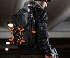 Is that dude going to fly his drone or catch some ghosts in a proton beam? Lowepro did not skimp on the drama and intrigue during its drone backpack photoshoot. Who is this mysterious quadcopter pilot with the excessively tidy gear packed into mo Spy Gadgets, High Tech Gadgets, Graffiti Pictures, Rc Cars And Trucks, Pilot, Drone For Sale, Rc Autos, Drone Technology, Drone Quadcopter