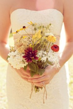 Natural Beauty. Amy Kuschel's Kennedy gown frames this hand-picked wildflower bouquet.