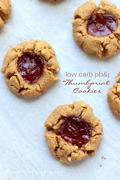Low Carb Peanut Butter & Jelly Thumbprint Cookies - - A low carb, keto, and gluten free cookie recipe inspired by the classic peanut butter and jelly sandwich! These keto peanut butter thumbprint cookies are sure to be a hit! Gluten Free Cookie Recipes, Gluten Free Cookies, Low Carb Recipes, Bar Recipes, Dessert Recipes, Healthy Recipes, Low Carb Deserts, Low Carb Sweets, Jelly Cookies