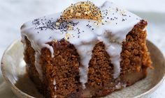 Slice of pear and ginger cake with hardened icing dripping down