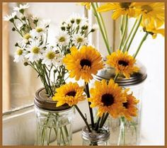 What's more Summer-y and bright than yellow and white daisies in Mason jars?