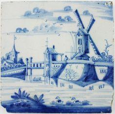 Antique Dutch Delft landscape tile in blue depicting a Post Mill and a bridge, 18th century