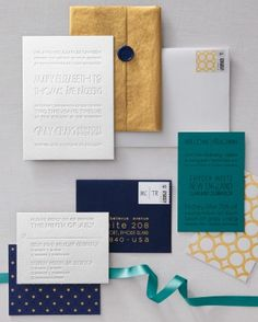 Peacock-Inspired invitation suite by Paper Moss. Gold, navy, teal, white, patterned, blind impression