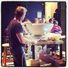 Sometimes you gotta torch it...Mark Skudlarek making a giant bowl at Functional Ceramics in Wooster OH. by ceramicartsdaily