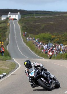 Bruce Anstey leads the opening Relentless Supersport race before mechanical problems hit