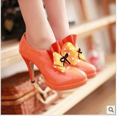 orange shoes with white polka dot bow