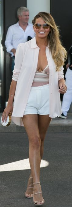 Chrissy Teigen wearing a sexy shorts and a blazer look.