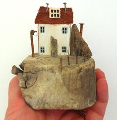 Sandcastle Cottage is approximate 10cm high, 8cm wide and 7cm deep. The paint is a pale sandy yellow with grey windows. [Your screen may show slightly different shades]. The railings, chimneys, lamppost and flag pole are made from rusty nails. The base, house, door and attic windows are driftwood. This piece has four, 6mm discreet plastic feet underneath to protect surfaces from scratch damage. UK POSTAGE INCLUDES NEXT DAY SIGNED FOR OPTION. US POSTAGE INCLUDES INTERNATIONAL, TRACKED…