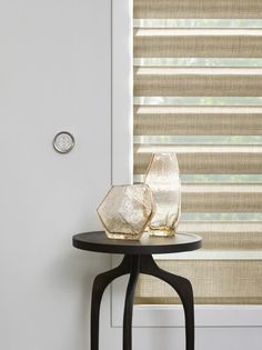 Raise and lower shades easily, conveniently and elegantly from any wall with the PowerView™ Motorization wall-mounted Surface Remote. Hunter Douglas Alustra® Pirouette® window shadings #MotorizedWindowTreatments