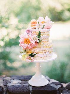 floral naked wedding cake - photo by Jessica Gold Photography http://ruffledblog.com/watercolor-garden-wedding-inspiration