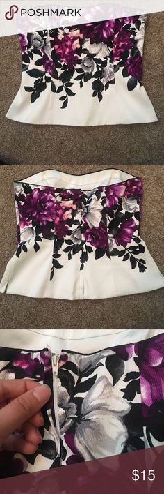 WHBM bustier with floral print size 8 Beautiful bustier size 8. Worn 2 times. Has back zipper and fabric that fold over to cover the zipper. White with big beautiful purple and grey flowers. Fitted to show off waist and looks great with jeans or blazer White House Black Market Tops