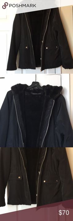 Black Designer Winter Jacket Black designer winter jacket with fur inside. Extremely warm and perfect with any winter outfit! It is a large children's sized jacket but it fits a petite woman. It is in great condition! Andrew Marc Jackets & Coats Puffers
