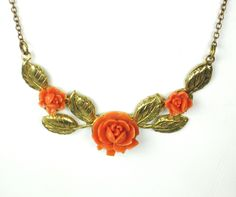 Coral Plastic and Gold Tone Gilt Metal Floral Necklace. $59.99, via Etsy.