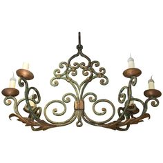 19th Century French Wrought Iron Chandelier   From a unique collection of antique and modern chandeliers and pendants  at https://www.1stdibs.com/furniture/lighting/chandeliers-pendant-lights/