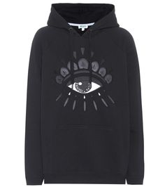 KENZO - Embroidered cotton hoodie - This season, Kenzo unleashed a soon-to-become familiar icon for the brand – a single eye, seen here embroidered on the label's cotton hoodie. The black oversized style is backed with brushed terrycloth for comfort and comes with the label's name on the pupil for recognition. - @ www.mytheresa.com
