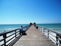 This is a shot going out onto the Naples Pier, in Naples Florida. Awesome place to visit - Bucket List! www.northnaplesliving.com