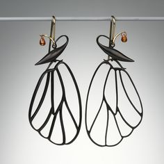 "Earrings | Gabriella Kiss.  ""Butterfly Cell"".  Oxidized bronze, orange sapphire drops and 14k gold earwires"