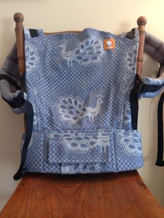 Didymos pfau blue white dress.