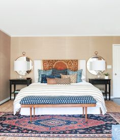 Eclectic Bedroom with Round Mirrors Above Nightstands | Amber Interiors